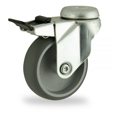 Zinc plated total lock caster 75mm for light trolleys,wheel made of grey rubber,plain bearing.Hollow rivet