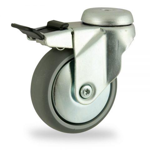 Zinc plated total lock caster 75mm for light trolleys,wheel made of grey rubber,plain bearing.Hollow rivet