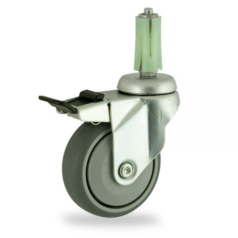 Zinc plated total lock caster 100mm for light trolleys,wheel made of grey rubber,single precision ball bearing.Fitting with round expander socket 26/30