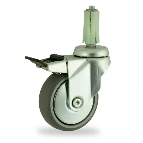 Zinc plated total lock caster 100mm for light trolleys,wheel made of grey rubber,double ball bearings.Fitting with round expander socket 23/26