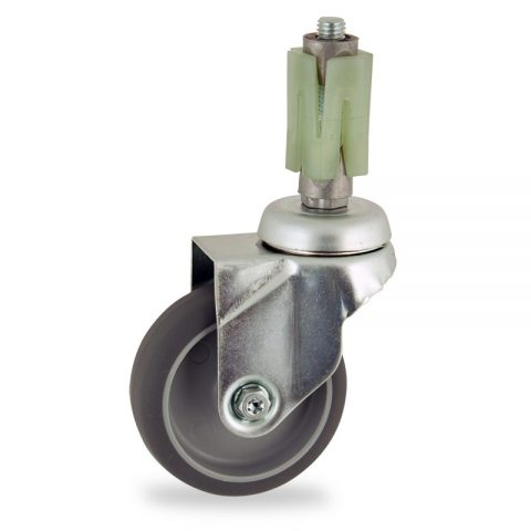 Zinc plated swivel caster 100mm for light trolleys,wheel made of grey rubber,double ball bearings.Fitting with square expander socket 21/24