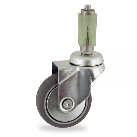 Zinc plated swivel caster 100mm for light trolleys,wheel made of grey rubber,double ball bearings.Fitting with square expander socket 27/31