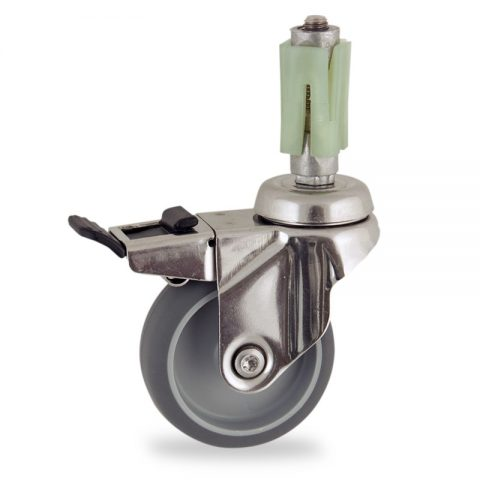 Stainless total lock caster 100mm for light trolleys,wheel made of grey rubber,double ball bearings.Fitting with square expander socket 27/31